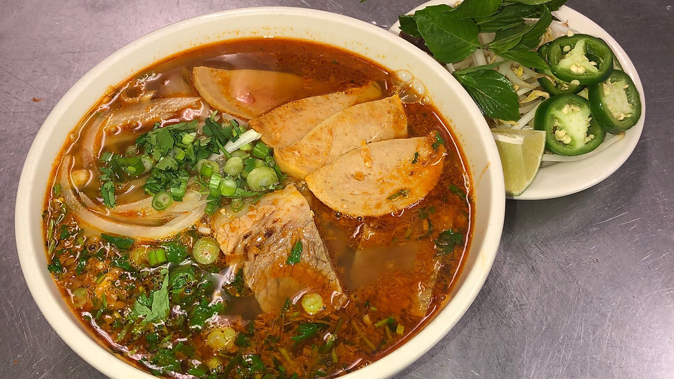 138.Spicy Soup with Rice Noodles, Pork Loaf Slices, Beef Brisket, onions & herbs