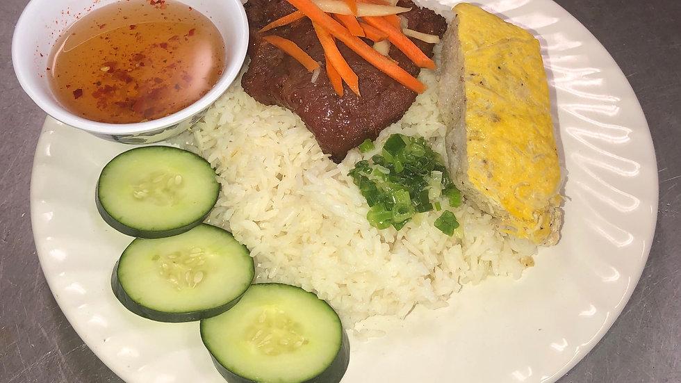 121. Steamed Rice Platter with Pork Chop, Meat Pie & Vegetables