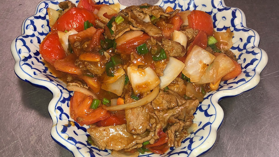 132. Beef Stir Fried with Tomatoes & Onions. Served with steamed rice.