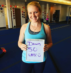 Girl in tank top lost 50 pounds in gym