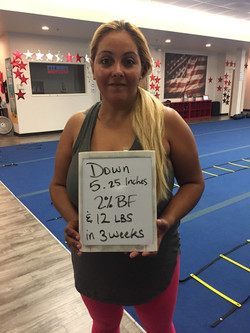 lady holding sign weight loss transformation