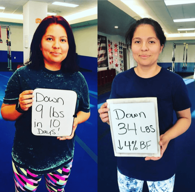 Girl lost weight in gym holding sign