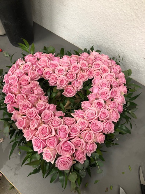Lyserød rose hjerte
