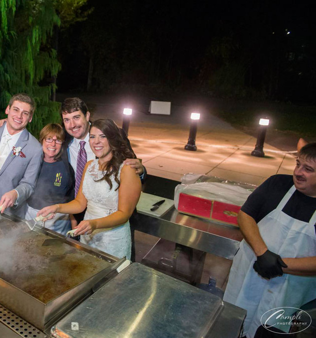 bride-&-groom-behind-the-grill.jpg