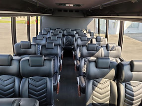 comfy leather seating in 27 passenger Coach bus