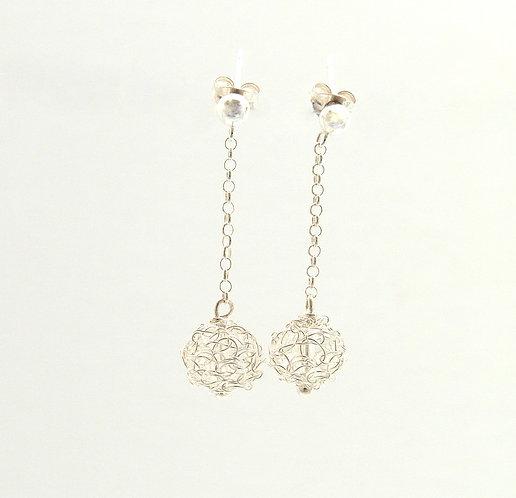 Globe dangling silver earrings