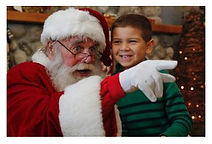 Isaiah Tubbs visit with Santa 2013.jpg