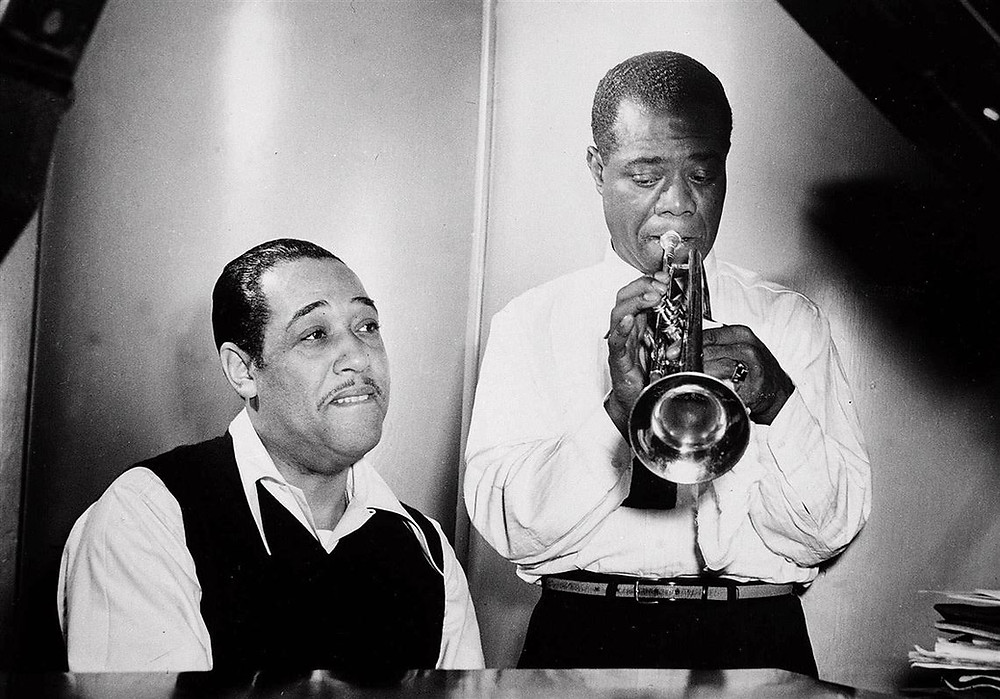 Duke Ellington at the piano and Louis Armstrong on trumpet rehearse Leonard Feather's 'Long, Long Journey' during a session at the RCA Victor recording studio in New York Jan. 12, 1946.