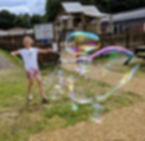 Girl making giant bubbles