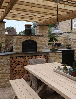 CUSTOM WOODFIRED PIZZA OVEN AND BBQ