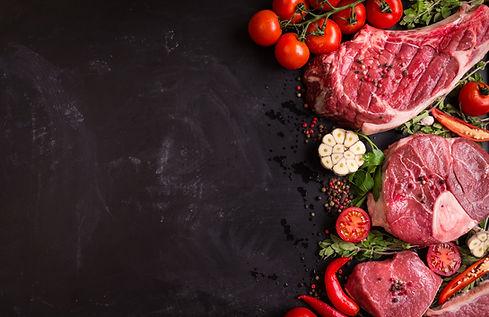 Raw juicy meat steaks ready for roasting