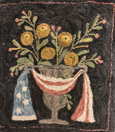 Maggie B. urn, flag and flowers
