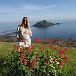 pregnant-woman-on-beach-cliff-top-overlo