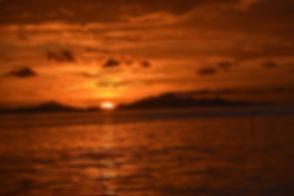Sunset Over Ra'iatea From Huahine.jpg