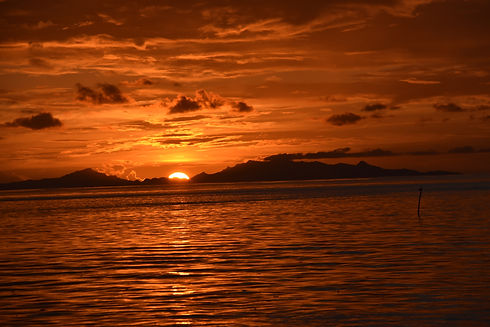 Sunset Over Ra'iatea From Huahine.jpg