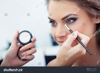 stock-photo-make-up-artist-applying-whit