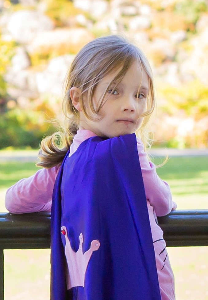 Charlotte wearing super hero cape