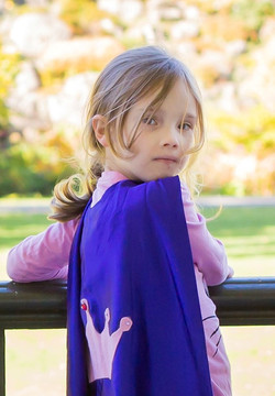 Charlotte wearing super hero cape