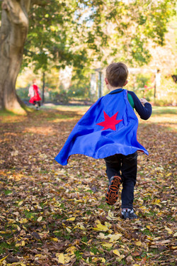 Alex with blue super hero cape and