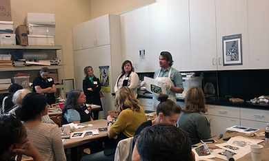 Group of art teachers learning about printmaking.