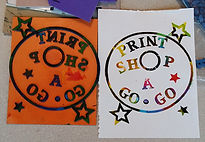 Print Shop a Go-Go printing plate with multicolor print.