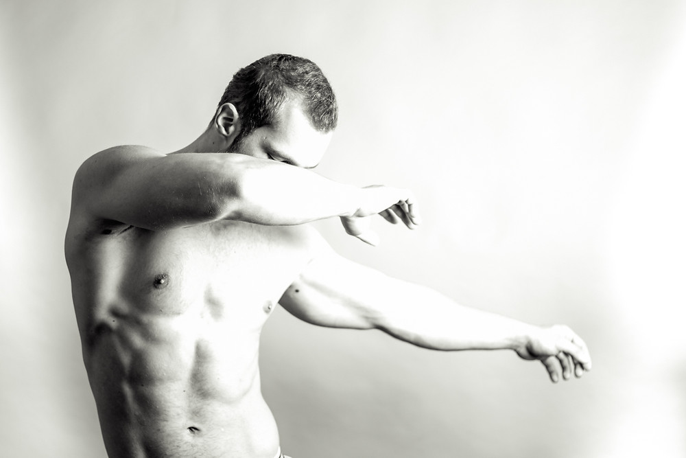 Body builder posing in a studio