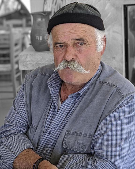 Greek worker taking a lunch break at a local restaurant.