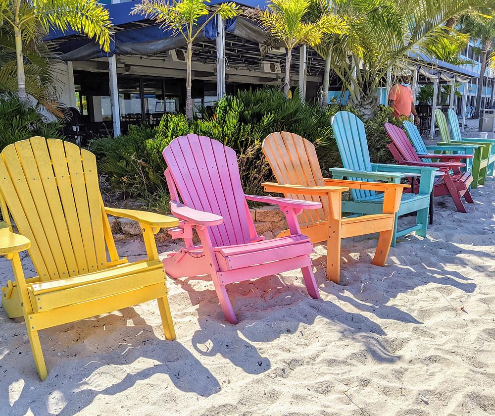 Colorful beach chairs along the boardwalk in Treasure Island, FL.