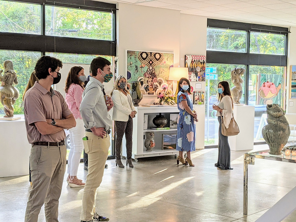 Visitors listening to Denny Gerwin talking about his sculptures at the Sozo Gallery in Charlotte, NC.