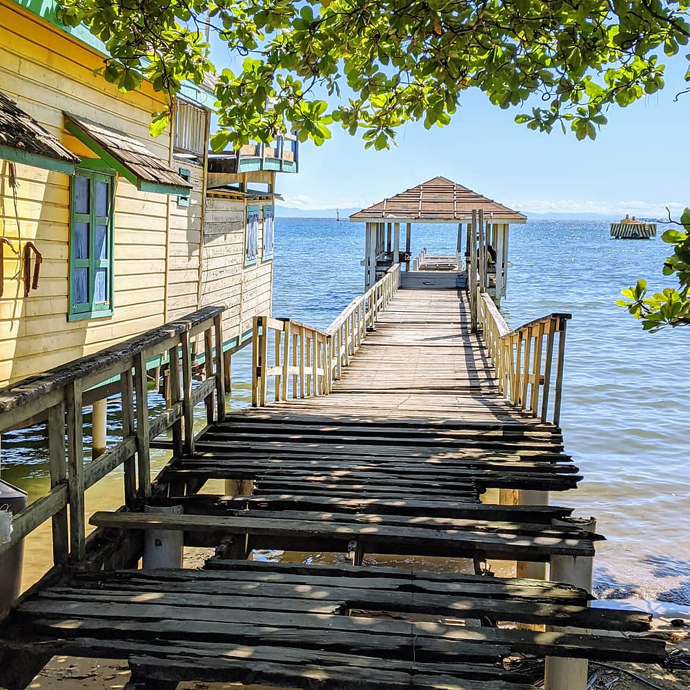 Pier and boathouse on Roatan. Photo by Rene Griffith.