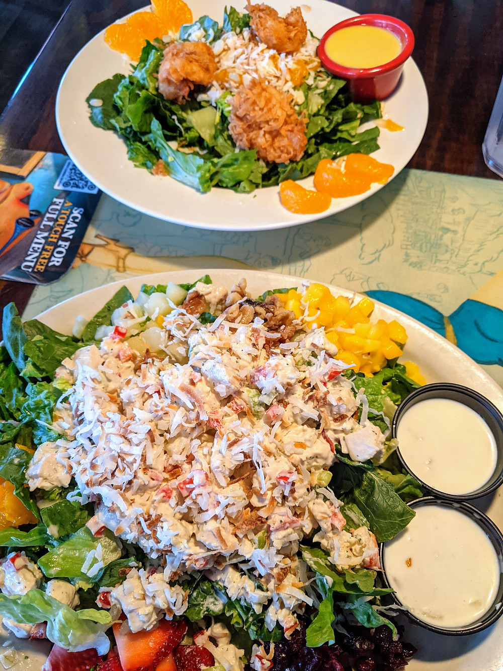 Fried coconut shrimp and chicken salad with flaked coconut.