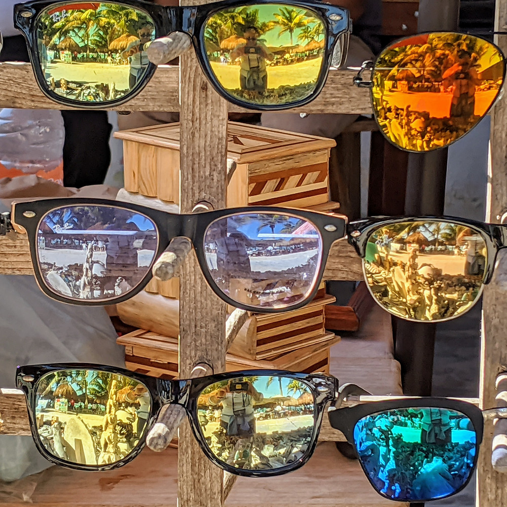 Sunglasses mirror the tropical scenes of Roatan. Photo by Rene Griffith.