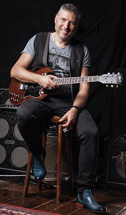 Rob Mo picture with guitar.png