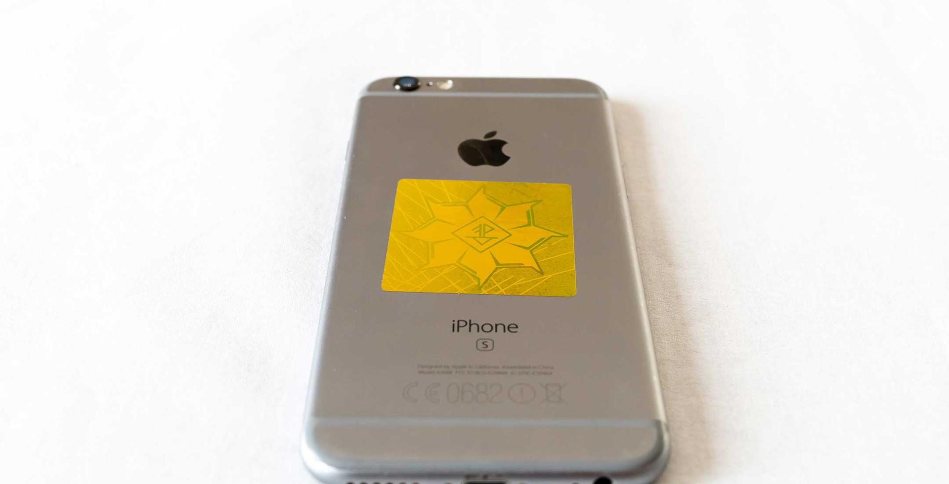 EMF sticker on iPhone.jpg