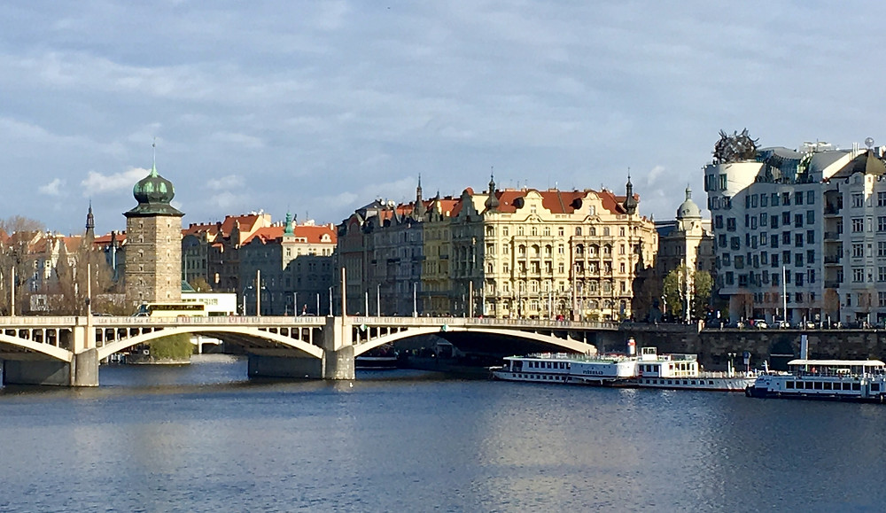 "View of the Moldau, incl (r to l, across bridge) the ""Dancing Building"", The National Theature"