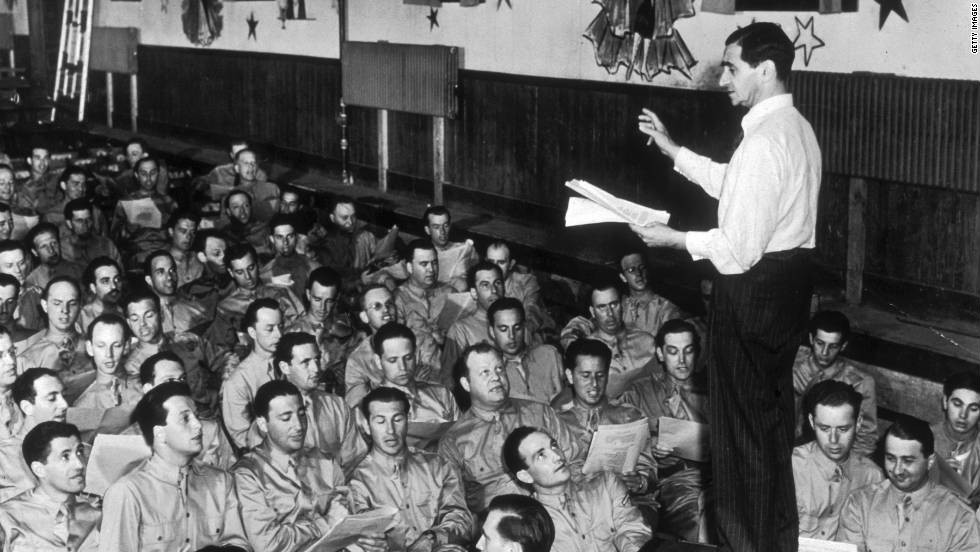 """Berlin conducting """"God Bless America"""" with troops in 1942"""