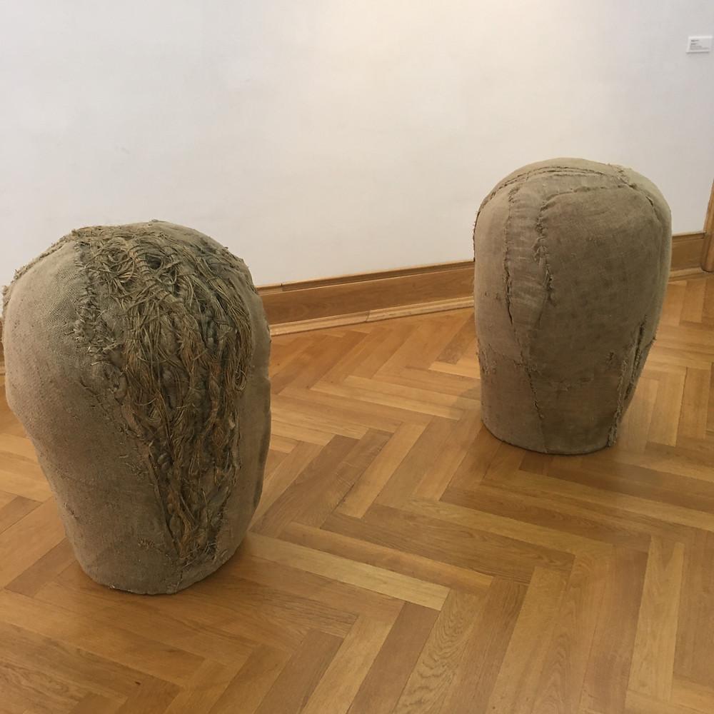 Abakanowicz: Heads (burlap, wood, resin)