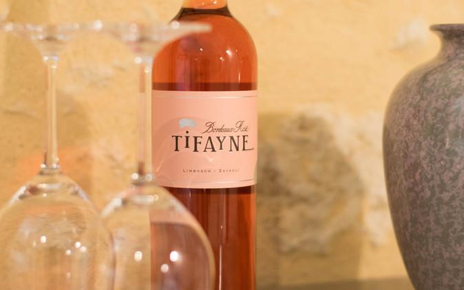 A glass of TIFAYNE Rosé