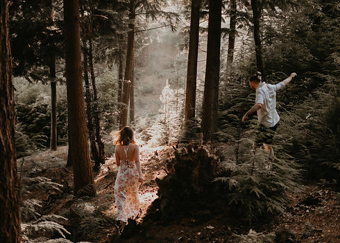 couple running in the woods