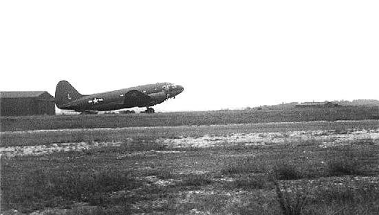C-46 by hangar at Greenham Common