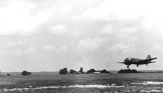 C-46 Commando flies into Greenham Common