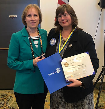 Sylvia Pauly is awarded a Paul Harris from Rotary of Newport President Julie Hanrahan.