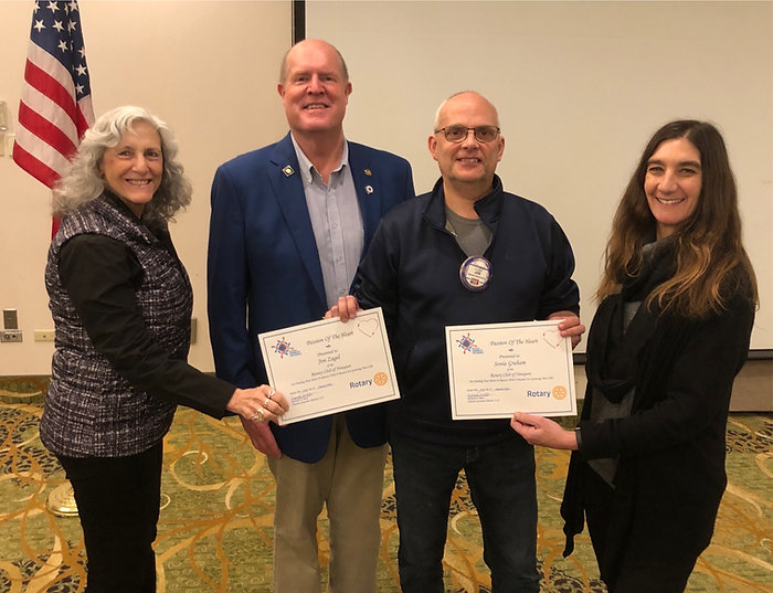 District Governor Rick Olson awards the Passion of the Heart to Diane Nelson, Jon Zagel and Sonia Graham of the Rotary Club of Newport on January 23, 2020.