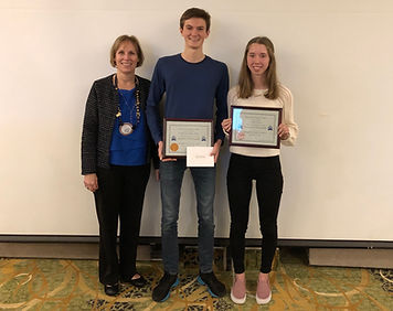 President Hanrahan recognizes the December Students of the Month Noah Goodwin-Rice and Emma Allen for the Rotary Club of Newport.