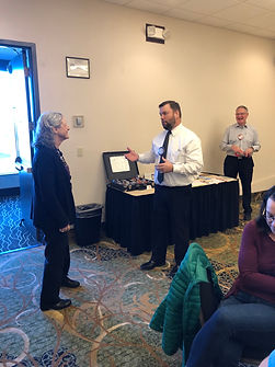 Richard O'Hearn demonstrates greeter duties at a Rotary of Newport meeting.