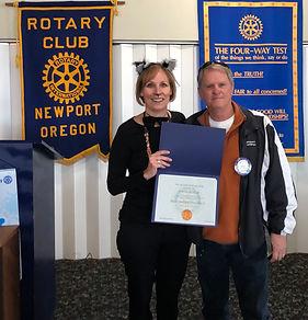 Newport Rotary President Julie Hanrahn awards Dave Heater a Paul Harris Fellow.