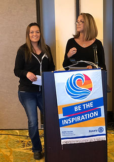 Michelle Law and Taunette Dixon of the Newport Fishermen's Wives speak at the Rotary Club of Newport.