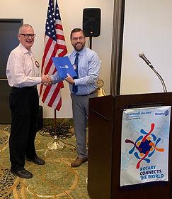 "Jim Graham earn his ""Blue Badge"" at the Rotary Club of Newport, Oregon"