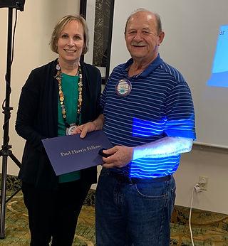 President Hanrahan awards Steve Johnson hisPaul Harris Fellow +4.