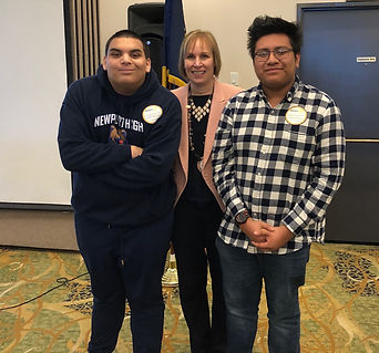 Rotary of Newport, OR President Julie Hanrahan recognizes th January Students of the Month Jobie Rasar and Josue Sanchez.